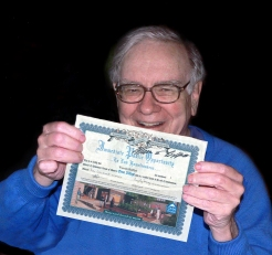 Warren Buffett with shares certificate
