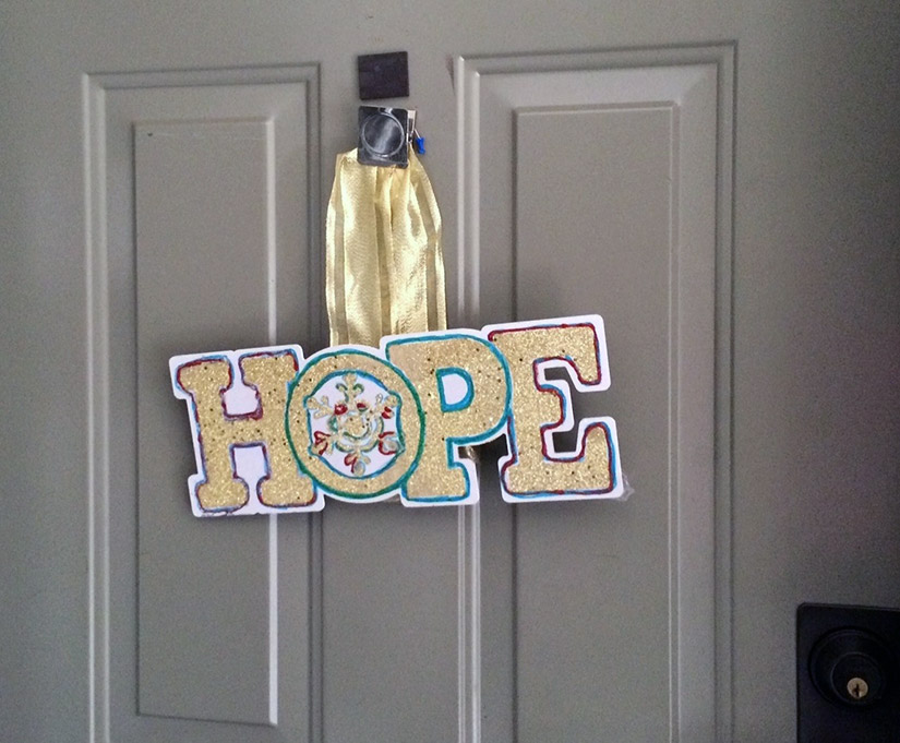 Hope sign hanging on door
