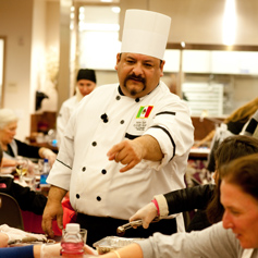 Chef guiding culinary students