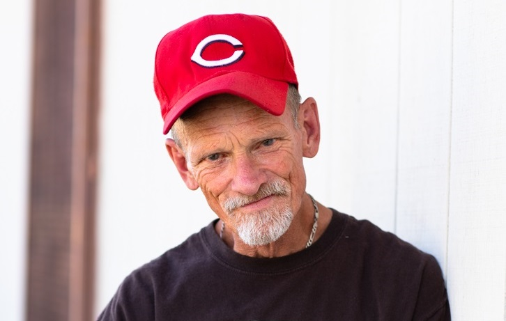 Man with baseball cap